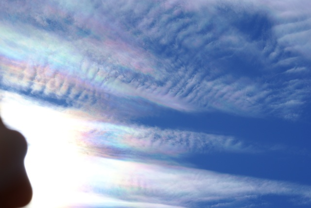 12.02pm on August 28th, 2011. Aerosol cloud matter over Whangarei, showing ripples, pink and blue.  Dark orange-brown was also visible to the eye, but did not show in the photograph.