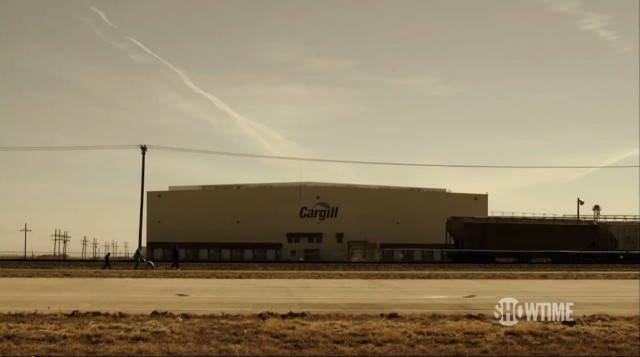 A screen shot from Years of Living Dangerously.  Outside the Cargill meatpacking plant, multiple aerosol trails litter the Plainview sky.