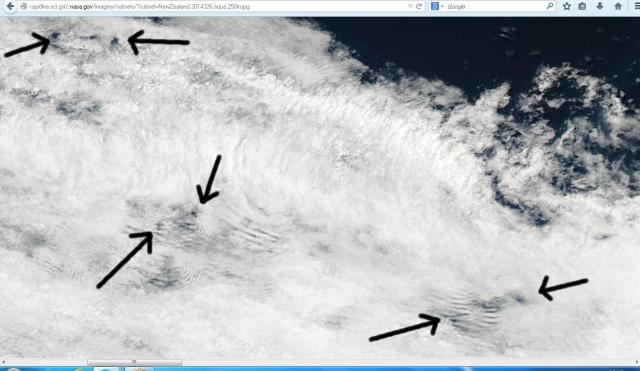 Satellite image showing cloud to the west of Northland, showing holes and ripples.