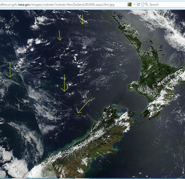 New year's day. Image from Aqua shows aerosol trails over the Tasman sea to the west of New Zealand.  Click to enlarge. Full image: http://rapidfire.sci.gsfc.nasa.gov/imagery/subsets/?subset=NewZealand.2015001.aqua.2km.jpg