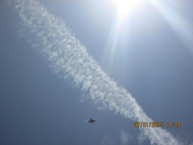 Photo: Sharon Turner. Aerosol trail expanding over Wanganui.