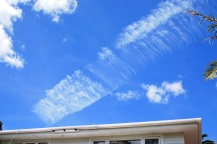 Whangarei, aerosol trail spreads out to pollute sky.